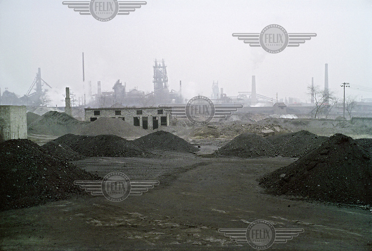 A brick factory looking towards a steel plant in Linfen, one of the most polluted cities in China. Supplying a large part of the nation's energy, Shanxi is considered to be the centre of China's expanding coal industry. The huge demand for coal has led to the development of hundreds of often illegal and unregulated coal mines, excessive air pollution and many other environmental problems.