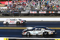 Jul. 28, 2013; Sonoma, CA, USA: NHRA pro stock driver Greg Anderson (far lane) races alongside Vincent Nobile during the Sonoma Nationals at Sonoma Raceway. Mandatory Credit: Mark J. Rebilas-