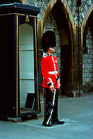 Guard stands watch in traditional bearskin busby uniform hat. military occupations. Queen's life guard. London England Great Britain Windsor Castle.
