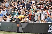 KANSAS CITY, KS - AUGUST 10: Referee Juan Gabriel Calderon checking VAR during a game between Club Leon and Sporting Kansas City at Children's Mercy Park on August 10, 2021 in Kansas City, Kansas.