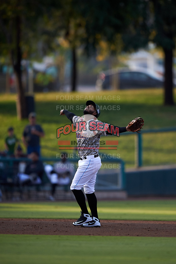 Inland Empire 66ers third baseman Alberto Triunfel (9) prepares to catch a pop fly during a California League game against the Lancaster JetHawks at San Manuel Stadium on May 19, 2018 in San Bernardino, California. Inland Empire defeated Lancaster 9-6. (Zachary Lucy/Four Seam Images)