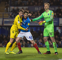 Fleetwood Town's Jack Sowerby (left) battles with Portsmouth's Steve Seddon (right), Portsmouth's Alex Bass (right) <br /> <br /> Photographer David Horton/CameraSport<br /> <br /> The EFL Sky Bet League One - Portsmouth v Fleetwood Town - Tuesday 10th March 2020 - Fratton Park - Portsmouth<br /> <br /> World Copyright © 2020 CameraSport. All rights reserved. 43 Linden Ave. Countesthorpe. Leicester. England. LE8 5PG - Tel: +44 (0) 116 277 4147 - admin@camerasport.com - www.camerasport.com