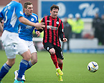 Queen of the South v St Johnstone...07.02.15    Scottish Cup 5th Round<br /> New signing Danny Swanson fends off Kevin Holt<br /> Picture by Graeme Hart.<br /> Copyright Perthshire Picture Agency<br /> Tel: 01738 623350  Mobile: 07990 594431