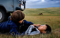 """Rowan, a five-year-old autistic child, communicates with six-year-old Bodibilguunson, the son of a guide, during a horseback expedition across Mongolia. Rowan, who has been nicknamed """"The Horse Boy"""", embarked on a therapeutic journey of discovery with his parents to visit a succession of shaman healers in one of the most remote regions in the world. Following Rowan's positive response to a neighbour's horse, Betsy, and some reaction to treatment by healers, Rowan's parents hoped that the Mongolian shamanistic rituals along the route and the prolonged contact with horses would help to unlock their son's autism and assist his development.."""