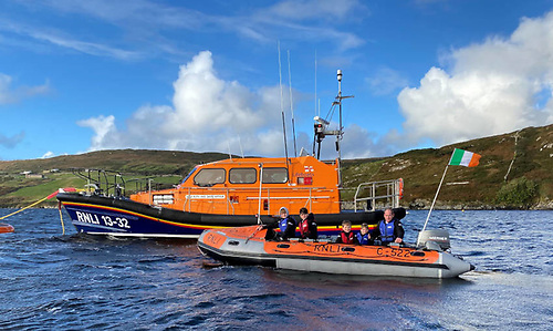 The Mullen family, from left: Cian (12), Ronan (14), Liam (9) and Enda (6) with dad James in their C-class 522, pictured alongside Clifden RNLI's all-weather lifeboat in Clifden Bay