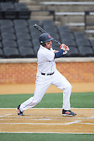 Rob Krentzman (23) of the Bucknell Bison follows through on his swing against the Georgetown Hoyas at Wake Forest Baseball Park on February 14, 2015 in Winston-Salem, North Carolina.  The Hoyas defeated the Bison 8-5.  (Brian Westerholt/Four Seam Images)