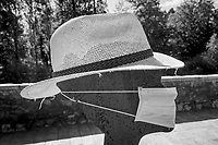 """Switzerland. Canton Ticino. Lugano. Restaurant terrace. <br /> A rusty metal sculpture of a person wearing a surgical mask and a summer hat. Due to the spread of the coronavirus (also called Covid-19), the Federal Council has categorised the situation in the country as """"extraordinary"""". It has issued a recommendation to all citizens to protect themselves and wear masks when appropriate. 20.05.2020 © 2020 Didier Ruef"""