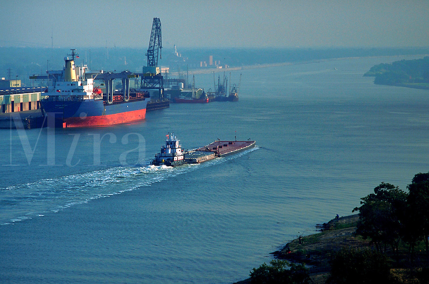 Container ship and Coast Guard boat, tug pushing barge, Port Arthur, Texas