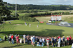 Tournament leader Peter Uihlein holes out on the 18th green to complete his third round of ISPS Handa Wales Open 2013 at the Celtic Manor Resort. <br /> <br /> 31.08.13<br /> <br /> ©Steve Pope-Sportingwales