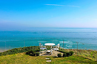 BNPS.co.uk (01202 558833)<br /> Pic: Savills/BNPS<br /> <br /> Pictured: The end of the garden with the panoramic sea view.<br /> <br /> A clifftop home with breathtaking panoramic sea views is on the market for £3.25m.<br /> <br /> Sandpierre also has a private swimming pool and a viewing platform overlooking the beach with 180-degree views of the water. <br /> <br /> The six-bedroom family home is on the Bournemouth/Poole coastline in Dorset and is being sold for the first time in 25 years.<br /> <br /> The house was built in the 1930s and is in a quiet cul-de-sac in Branksome Dene Chine - midway between the town centres of Bournemouth and Poole.