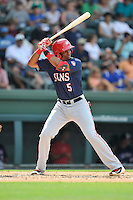 Third baseman Kelvin Gutierrez (5) of the Hagerstown Suns bats in a game against the Greenville Drive on Sunday, July 17, 2016, at Fluor Field at the West End in Greenville, South Carolina. Hagerstown won, 3-2. (Tom Priddy/Four Seam Images)