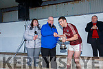 Dermot Walsh of Super Valu Cahersiveen, sponsor of the South Kerry Senior Football Championship presents Dromids Captain Niall Ó Sé with the Jack Murphy Cup on Saturday in Ballinskelligs after their 2 point win over St Marys after extra time.