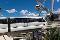 Las Vegas, Nevada.  Monorail, with High Roller in background.  The High Roller is the world's tallest observation wheel, as of 2015.