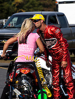 Oct 6, 2013; Mohnton, PA, USA; NHRA pro stock motorcycle rider Matt Smith (right) kisses wife Angie Smith as they celebrate after winning the Auto Plus Nationals at Maple Grove Raceway. Mandatory Credit: Mark J. Rebilas-