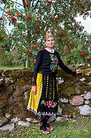 Estonia, Muhu Island. Muhu Jaanalind, guest house and farm. Traditional dancer.