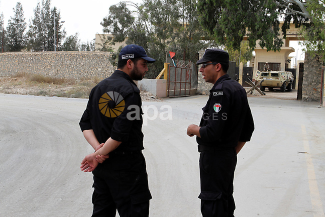 Palestinian policemen stand guard at the Rafah border crossing between Egypt and southern Gaza Strip May 26, 2015. Egyptian authorities opened the Rafah crossing on Tuesday, for the first time in nearly 80 days, to allow stranded Palestinians to return to the Gaza Strip, witnesses and officials said. But it did not allow traffic the other way, leaving thousands of Gazans, some of whom need to travel for medical treatment, stuck inside the tiny enclave, authorities there said. Photo by Abed Rahim Khatib