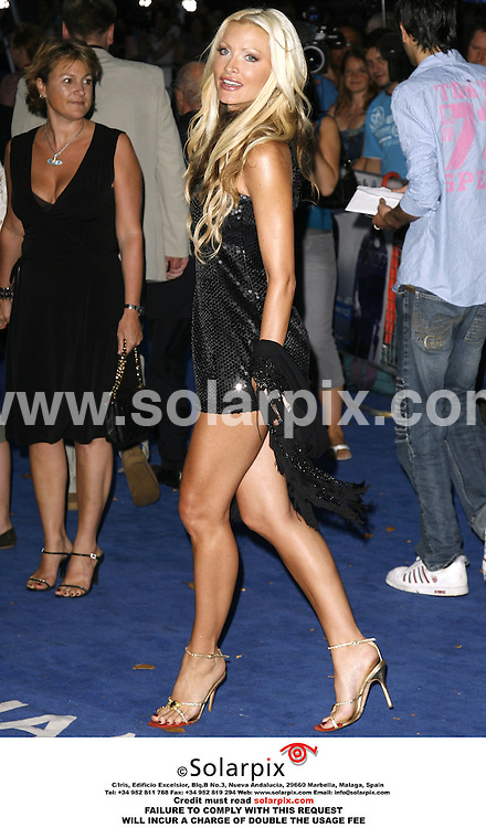 """ALL ROUND PICTURES BY SOLARPIX.COM.*MUST CREDIT SOLARPIX.COM OR DOUBLE WILL BE CHARGED*.The premiere of the film """"Miami Vice"""" at the Odeon Leicester Square in the west end of London yesterday..This pic:CAPRICE BOURET..DATE:28_07_06-JOB REF:2642-PRS"""