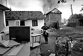 Grace, Kosovo<br /> 1999<br /> <br /> Ethnic Albanian Kosovars burn and loot the homes of fleeing Serbian residents after NATO arrives and the Serb forces withdraw. NATO does nothing to stop the act.