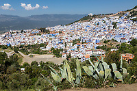 """Chefchaouen, Morocco.  View of the Town from the Trail Leading to the """"Spanish Mosque.""""  Rif Mountains in the Background."""