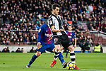 Sergio Postigo Redondo (R) of Levante UD fights for the ball with Lionel Andres Messi of FC Barcelona during the La Liga 2017-18 match between FC Barcelona and Levante UD at Camp Nou on 07 January 2018 in Barcelona, Spain. Photo by Vicens Gimenez / Power Sport Images