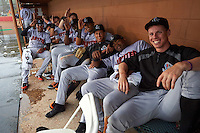 Jupiter Hammerheads Rehiner Cordova, Chris Hoo, Brian Schales, Ryan Aper, K.J. Woods, John Norwood, Luis Castillo, Yuniel Ramirez and Jeff Brigham in the dugout for a rain delay during a game against the Lakeland Flying Tigers on March 14, 2016 at Henley Field in Lakeland, Florida.  Lakeland defeated Jupiter 5-0.  (Mike Janes/Four Seam Images)