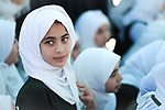 A school girl wearing veil with green eyes and ambitious look. Photo by Sanad Ltefa
