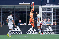 FOXBOROUGH, MA - JULY 25: James Pantemis #41 of CF Montreal leaps to save a shot on goal during a game between CF Montreal and New England Revolution at Gillette Stadium on July 25, 2021 in Foxborough, Massachusetts.