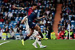 Real Madrid's Nacho Fernandez and SD Huesca's Luis Ezequiel 'Chimy' Avila during La Liga match between Real Madrid and SD Huesca at Santiago Bernabeu Stadium in Madrid, Spain.March 31, 2019. (ALTERPHOTOS/A. Perez Meca)