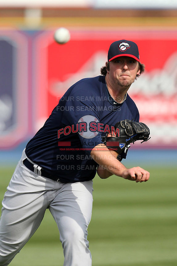 New Hampshire Fisher Cats pitcher Deck McGuire #13 throws in the outfield before a game against the Reading Phillies at FirstEnergy Stadium on April 10, 2012 in Reading, Pennsylvania.  New Hampshire defeated Reading 3-2.  (Mike Janes/Four Seam Images)