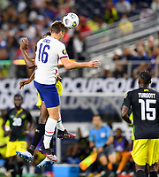 DALLAS, TX - JULY 25: James Sands #16 of the United States goes up for a header with Cory Burke #9 of Jamaica during a game between Jamaica and USMNT at AT&T Stadium on July 25, 2021 in Dallas, Texas.