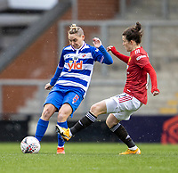 7th February 2021; Leigh Sports Village, Lancashire, England; Women's English Super League, Manchester United Women versus Reading Women; Jess Fishlock of Reading is tackled by Hayley Ladd of Manchester United Women