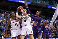 GREENSBORO, NC - MARCH 6: Georgia Pineau #5 of Boston College is fouled by Tylar Bennett #55 of Clemson University during a game between Clemson and Boston College at Greensboro Coliseum on March 6, 2020 in Greensboro, North Carolina.