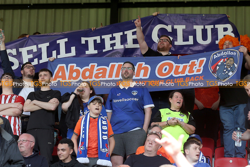 Oldham fans with an 'Abdallah Out' banner protest during Leyton Orient vs Oldham Athletic, Sky Bet EFL League 2 Football at The Breyer Group Stadium on 11th September 2021