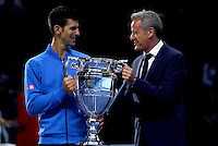 Novak Djokovic of Serbia receives the year end ATP Rankings No.1 Trophy from ATP Chairman and President Chris Kermode at the ATP World Tour Finals, The O2, London, 2015
