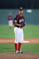 Batavia Muckdogs pitcher Brett Lilek (32) gets ready to deliver a pitch during the first game of a doubleheader against the Vermont Lake Monsters August 11, 2015 at Dwyer Stadium in Batavia, New York.  Batavia defeated Vermont 6-0.  (Mike Janes/Four Seam Images)