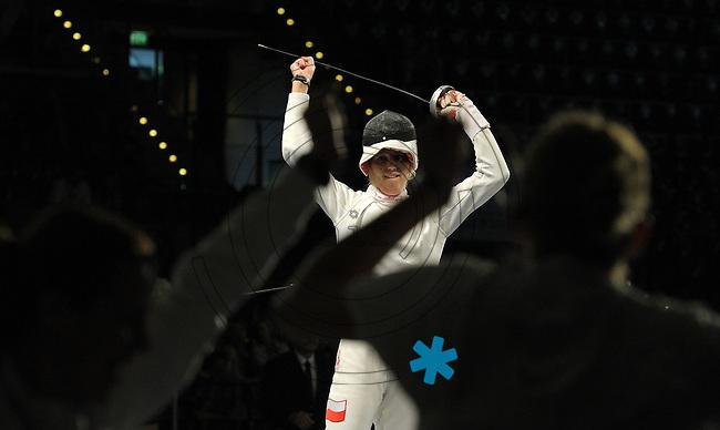 European Championships Fencing 2010 / Fecht Europameisterschaft 2010 in Leipzig - Competition Championat d'europe - im Bild: womens epee team finale - Poland : Italy - Magdalena Piekarska gets the last point for Poland and makes the team the new European Champion  . Foto: Norman Rembarz..Norman Rembarz , Autorennummer 41043728 , Augustenstr. 2, 04317 Leipzig, Tel.: 01794887569, Hypovereinsbank: BLZ: 86020086, KN: 357889472, St.Nr.: 231/261/06432 - Jegliche kommerzielle Nutzung ist honorar- und mehrwertsteuerpflichtig! Persönlichkeitsrechte sind zu wahren. Es wird keine Haftung übernommen bei Verletzung von Rechten Dritter. Autoren-Nennung gem. §13 UrhGes. wird verlangt. Weitergabe an Dritte nur nach  vorheriger Absprache..