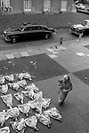 Hoxton east London. Funeral woman bring flowers and tp pay her respect. 1978.<br /> <br /> My ref 16/3514/, 1978,