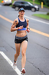MIDDLEBURY, CT 070721JS20 Cassandra Maximenko of Watertown takes to the street in the running portion during the 35th annual Pat Griskuus Triathlon held Wednesday at Quassy Amusement Park in Middlebury. Maximenko would go on to win the female division. <br /> Jim Shannon Republican American