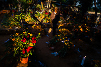 A Mexican man walks amongst the flower-decorated gravesites during the Day of the Dead celebrations in Oaxaca, Mexico, 1 November 2019. Day of the Dead (Día de Muertos), a religious holiday combining the death veneration rituals of Pre-Hispanic cultures with the Catholic practice, is widely celebrated throughout all of Mexico. Based on the belief that the souls of the departed may come back to this world on that day, people gather together while either praying or joyfully eating, drinking, and playing music, to remember friends or family members who have died and to support their souls on the spiritual journey.