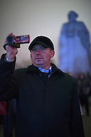 Moscow, Russia, 28/10/2011..A man videos the scenes in Ploschad Revolutsii opposite the Bolshoi Theatre, as crowds watch the gala opening night on giant  outdoor video screens. The theatre had been closed since 2005 for reconstruction work that cost some $700 million.