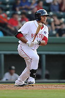 First baseman Boss Moanaroa (29) of the Greenville Drive bats in a game against the Charleston RiverDogs on Wednesday, June 12, 2013, at Fluor Field at the West End in Greenville, South Carolina. Charleston won, 10-5. The teams wore their Boston and New York affiliate uniforms as part of a promotion. (Tom Priddy/Four Seam Images)