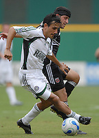 Colorado Rapdis midfilder Pablo Mastroeni fights for control of the ball and is defended by DC United forward Alecko Eskandarian (11). DC United tied the Colorado Rapids 1-1, Saturday, August 19, 2006 at RFK Stadium.