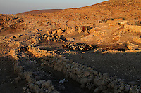 """A shepherd with his sheep is at sunrice in Jenba a Palestinian town of 50 families seats in an area called by the IDF as """"Firing Zone 918"""" and is located in the southern Hebron hills near the town of Yatta.  Spread over 30,000 dunams, it includes twelve Palestinian villages.  According to OCHA figures, 1,622 people lived in the area in 2010, and according to local residents the number of inhabitants currently stands at about 1,800. For over a decade, the residents of twelve uniquely traditional Palestinian villages in the area of Masafer-Yatta in the south Hebron hills have lived under the constant threat of demolition, evacuation, and dispossession.<br /> <br /> The State's insistence on evacuation of Firing Zone 918 in part or in whole, if acceptance by the HCJ, might result in an immediate humanitarian disaster for almost two thousand souls, the destruction of villages, and the eradication of a remarkable way of life that has endured for centuries."""