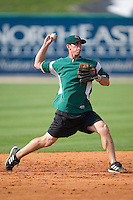 Augusta shortstop Anthony Contreras makes a throw to first during batting practice at Fieldcrest Cannon Stadium in Kannapolis, NC, Saturday, June 17, 2006.