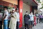 Indian people qued up for medicines at a medical store in Kolkata midst 21 days lockdown in the country for Corona Virus pandemic. Kolkata, West Bengal, India, Arindam Mukherjee.