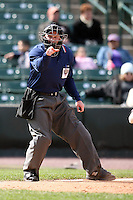 May 10, 2009:  Home plate umpire Fran Burke signals a strike one call during a game at the Frontier Field in Rochester, NY.  Photo by:  Mike Janes/Four Seam Images