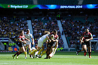 Mako Vunipola of Saracens is tackled by Gerhard Vosloo of ASM Clermont Auvergne during the Heineken Cup semi-final match between Saracens and ASM Clermont Auvergne at Twickenham Stadium on Saturday 26th April 2014 (Photo by Rob Munro)