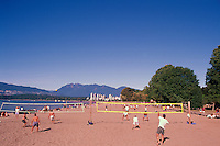 People playing Beach Volleyball at Kitsilano Beach along English Bay, Vancouver, BC, British Columbia, Canada, Summer - West End, City, Stanley Park, and North Shore Mountains (Coast Mountains) beyond