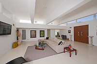 Mid-century modern living room is seen with modern furniture