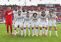 Toronto, Ontario - May 3, 2014: The starting eleven of the New England Revolution during a game between the New England Revolution and Toronto FC at BMO Field.<br /> The New England Revolution won 2-1.